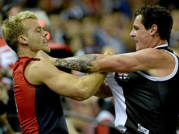 Demon Jack Watts and Saint Jake Carlisle clash during their round one AFL match.