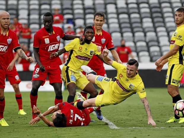 Roy O'Donovan of the Mariners clashes with Kim Jae-sung of Adelaide United during their A-League match.