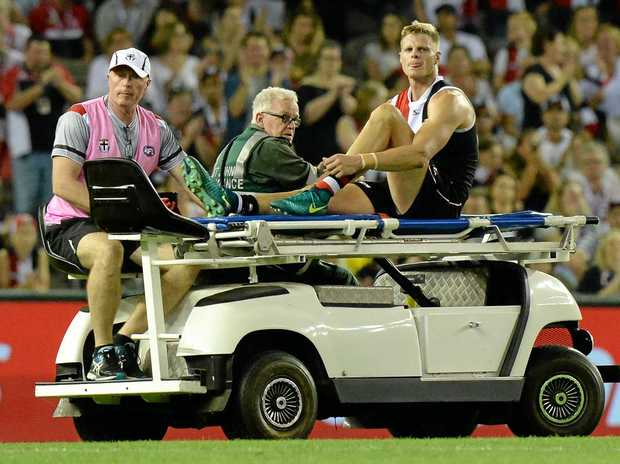Nick Riewoldt is stretchered off after injuring his knee in the loss to Melbourne.