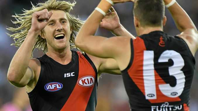 Dyson Heppell (left) and Orazio Fantasia of the Bombers react after Fantasia kicked a goal against the Hawks.