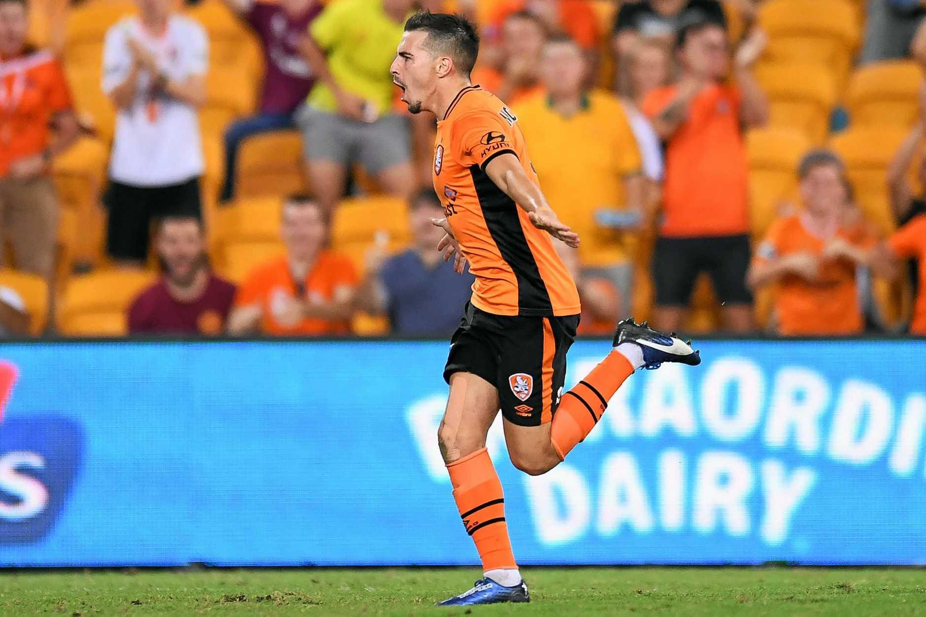 Jamie MacLaren celebrates his goal against Melbourne Victory.