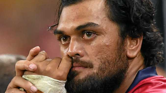Reds player Karmichael Hunt watches on from the sin-bin in the final minutes of the Super Rugby match against the Sharks.