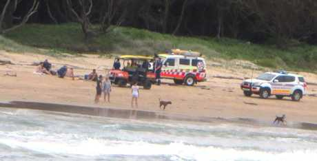 Three swimmers have been pulled from a rip with two requiring treatment by paramedics.