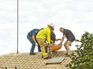 Man rescued from roof