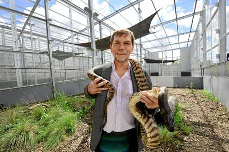 The new conservation and wildlife centre at Hidden Vale. Graham Turner of the Turner family foundation has set up a $18.5m wildlife centre with UQ. Pictured with Zorro a Black Headed Python.