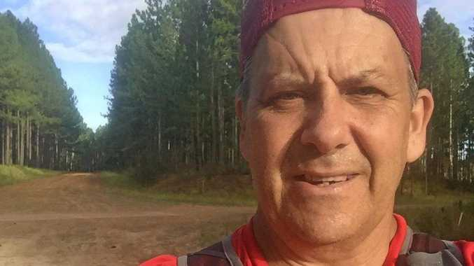 IN TRAINING: Neil Collie runs trails around the scenic Glass House Mountains area in preparation for the 250km Big Red Run.