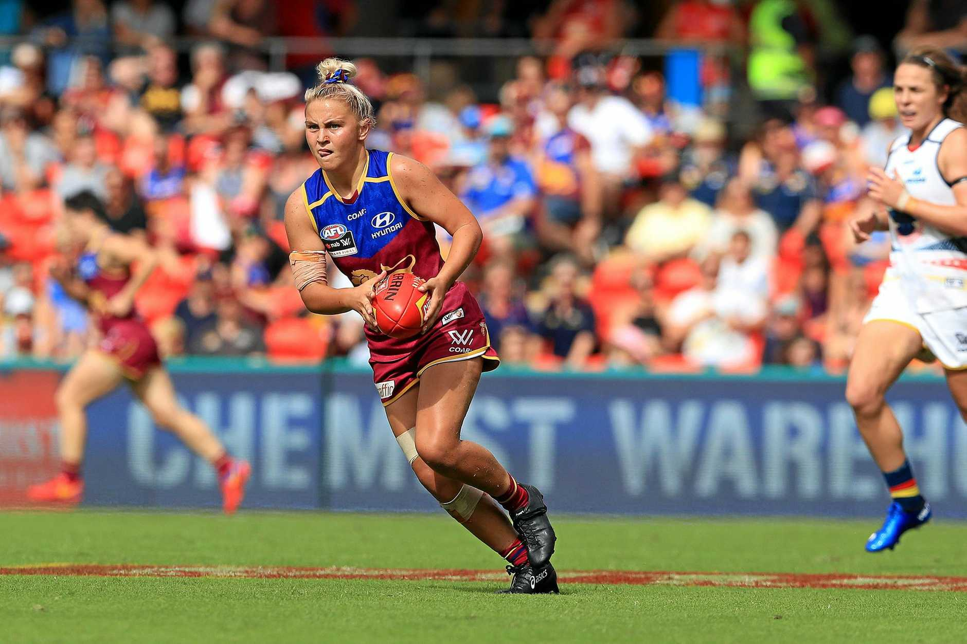 Megan Hunt looks for a teammate during the AFLW Grand Final between the Brisbane Lions and Adelaide Crows at Metricon Stadium on the Gold Coast.