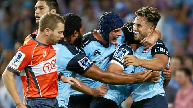 David Horwitz of the Waratahs (right) celebrates teammates after scoring the winning try against the Rebels.