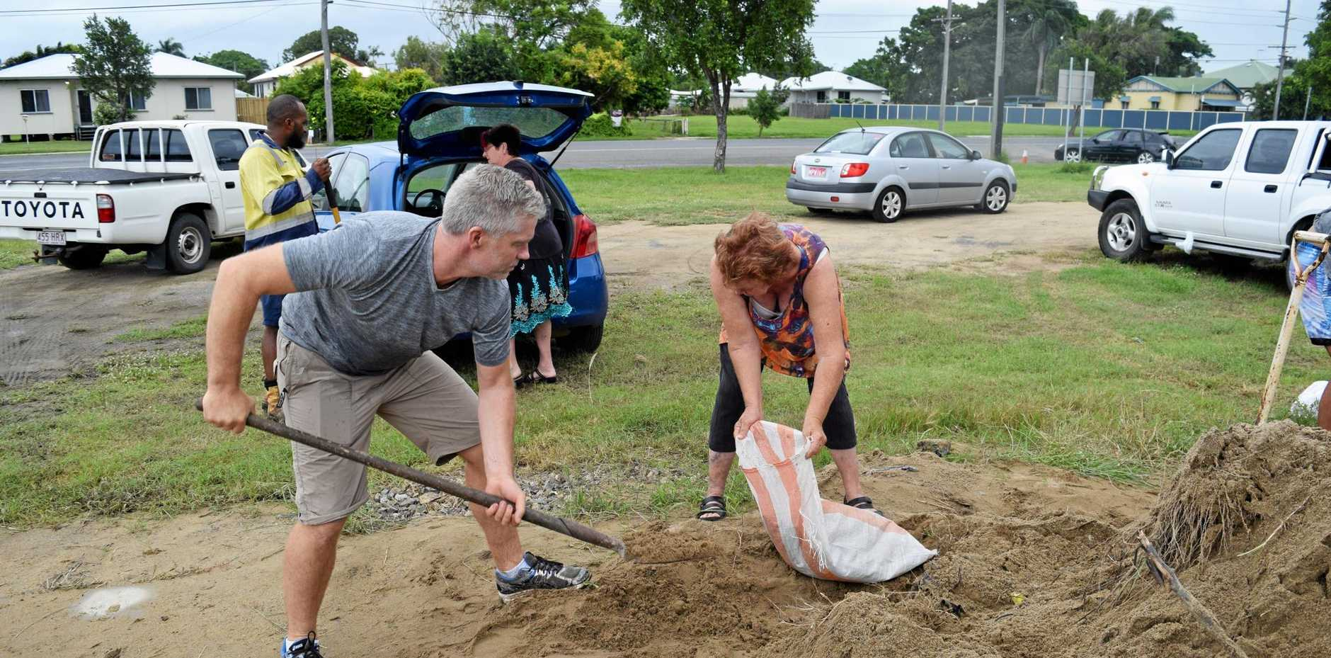 Craig Eberhardt, from Brisbane, was out helping residents fill sand bags.
