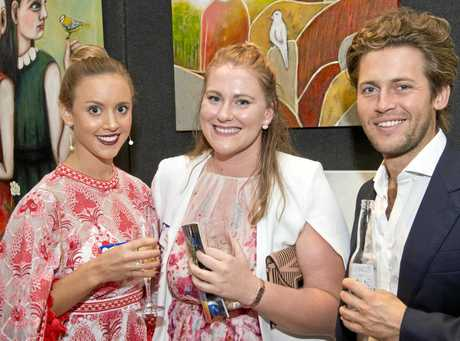 PRESTIGE: Enjoying the Toowoomba Grammar School Art Show are (from left) Mary Grant, Sarah-Jane MacDonald and James Cook.