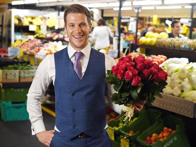 Jesse Konstantinoff pictured outside his parent's McMahons Fruit and Veg stall at the Adelaide Central Market.