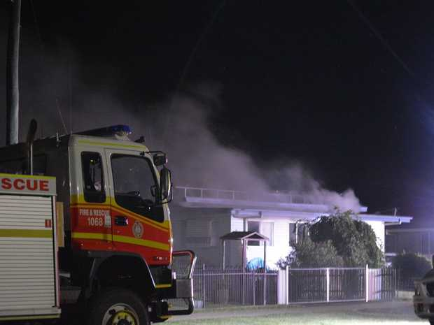 Emergency services contain a fire which broke out in a Wyley St home in Dalby early Monday morning.