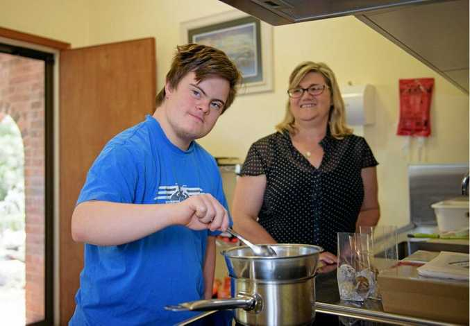 Ben Hunter has started his own commercial kitchen with support from two NDIS support workers and his mum, Carolyn. Photo: contributed