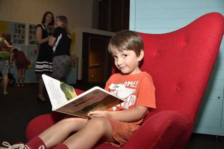 In the comfy red reading chair, Diego Ryan. Play School exhibition opens at Cobb+co Museum. March 27, 2017