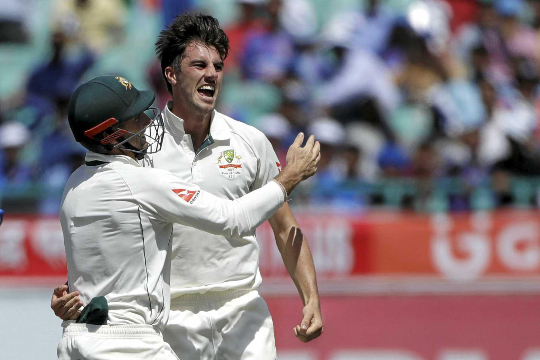 Australia's Pat Cummins, right, celebrates the dismissal of India's Lokesh Rahul