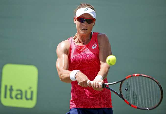 Samantha Stosur, of Australia, returns a shot from Shuai Peng, of China, during a tennis match at the Miami Open, Sunday, March 26, 2017, in Key Biscayne, Fla. (AP Photo/Wilfredo Lee)bra