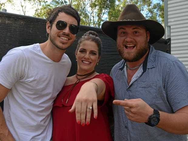 CMC Rocks Queensland performer Morgan Evans shared the stage with Rockhampton couple Nadine Hill and Brodie Whitcombe. Brodie proposed in front of a packed crowd during Saturday night's show.
