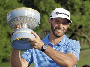 Dustin Johnson holds his trophy after defeating Jon Rahm of Spain at the Dell Technologies Match Play.