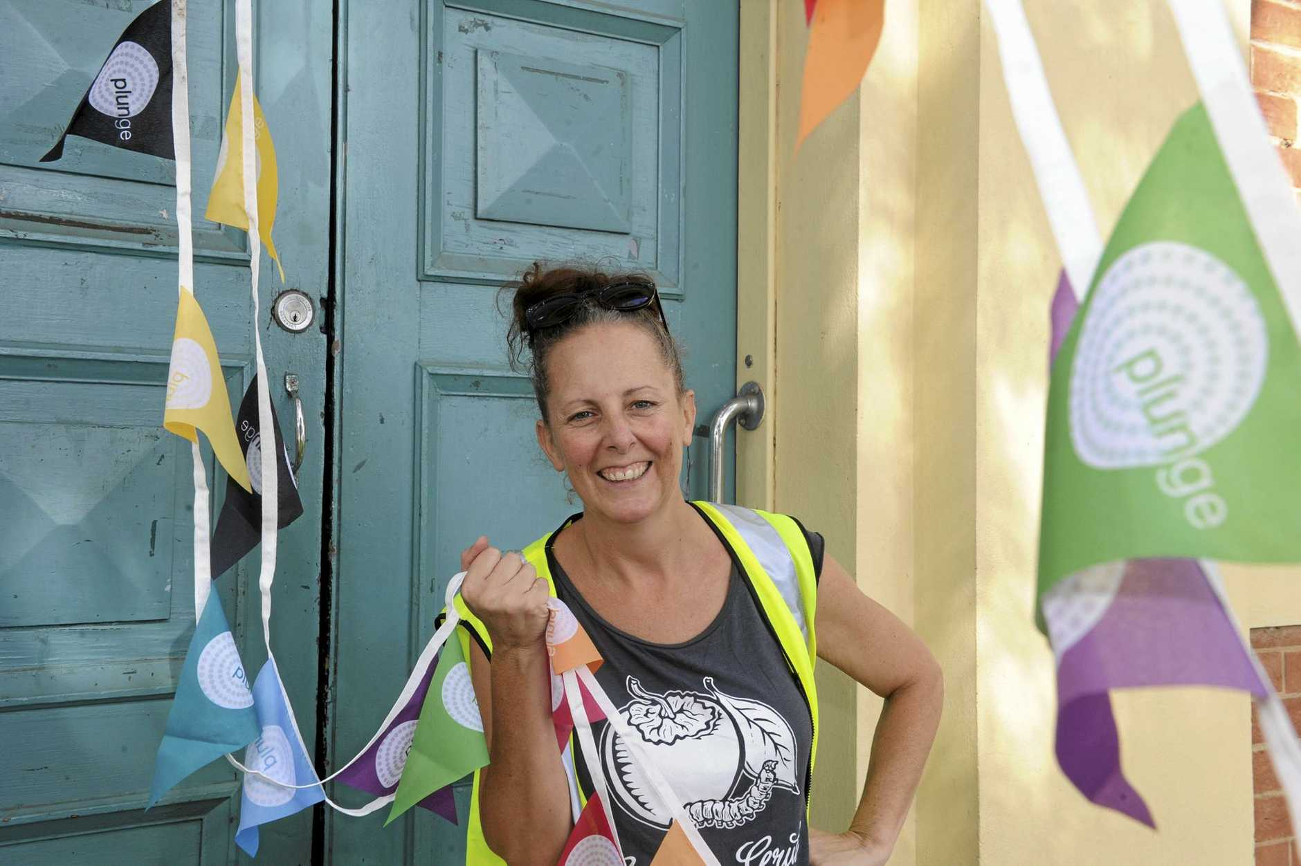 SPLASH OF COLOUR: Plunge co-ordinator Sarah Nash is helping add a splash of colour with bunting installed in South Grafton ahead of the festival's start this weekend.