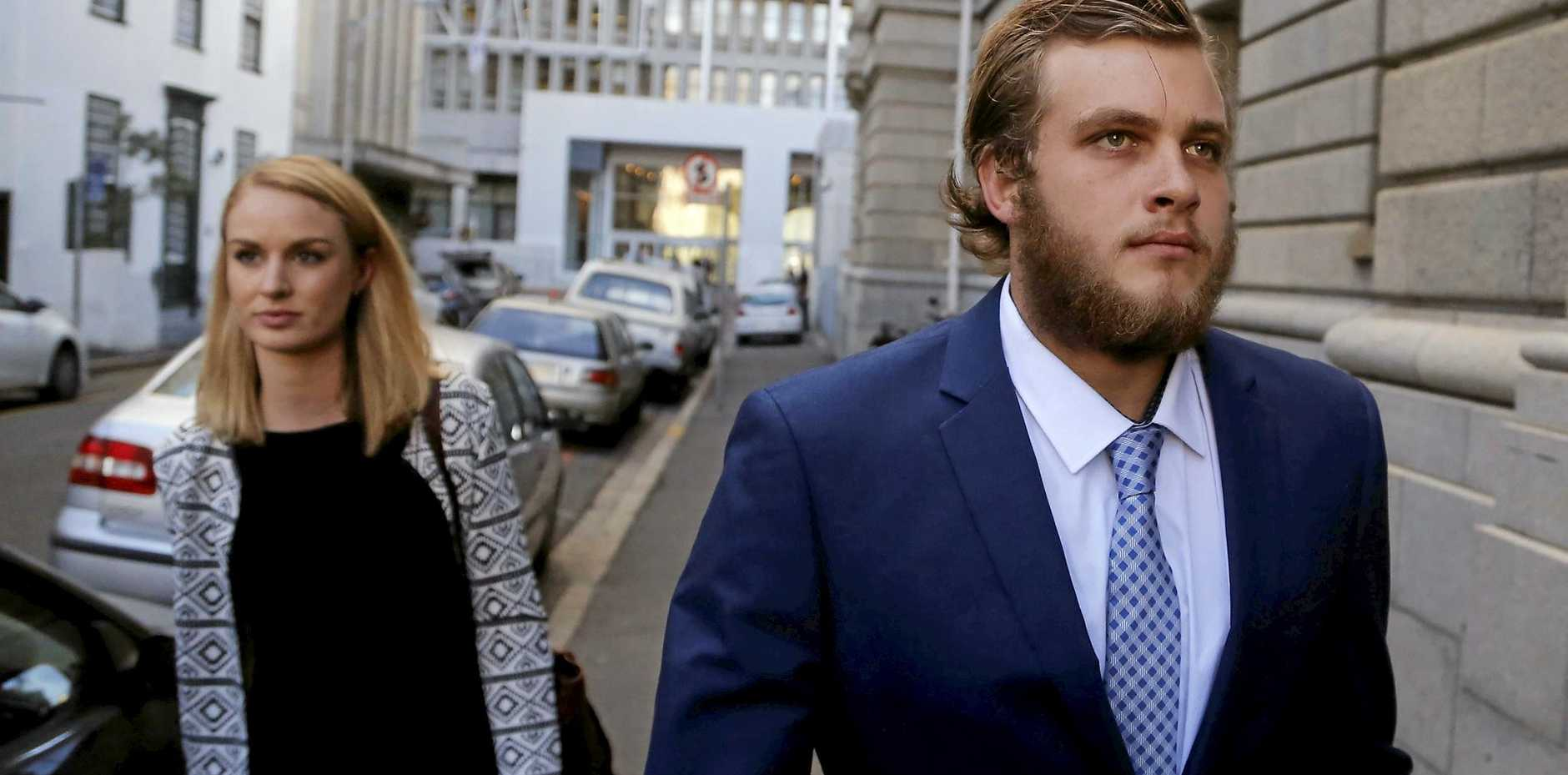 ACCUSED: South African murder accused Henri van Breda arrives at the high court in the city of Cape Town, South Africa. Van Breda, faces three counts of murder for allegedly killing his parents and older brother with an axe.