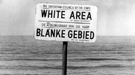Sign at a Cape Town beach in the 1980s, indicating whites only and blacks or coloureds are not allowed.