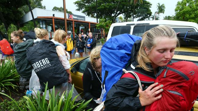 Backpackers leave Airlie Beach as Cyclone Debbie approaches. Picture: Liam Kidston
