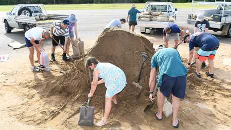 Townsville residents fill sandbags in preparation for Cyclone Debbie. Picture: Ian Hitchcock