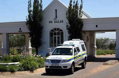 Police vehicle exits the upmarket De Zalze housing estate in Stellenbosch, South Africa, where three members of the van Breda family were killed, and two injured.