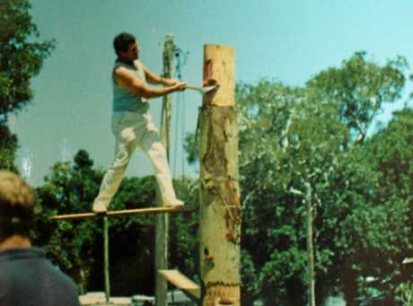FLYING CHIPS: Ivan Preston competing in the tree falling at Bellingen Show in the 1970s.