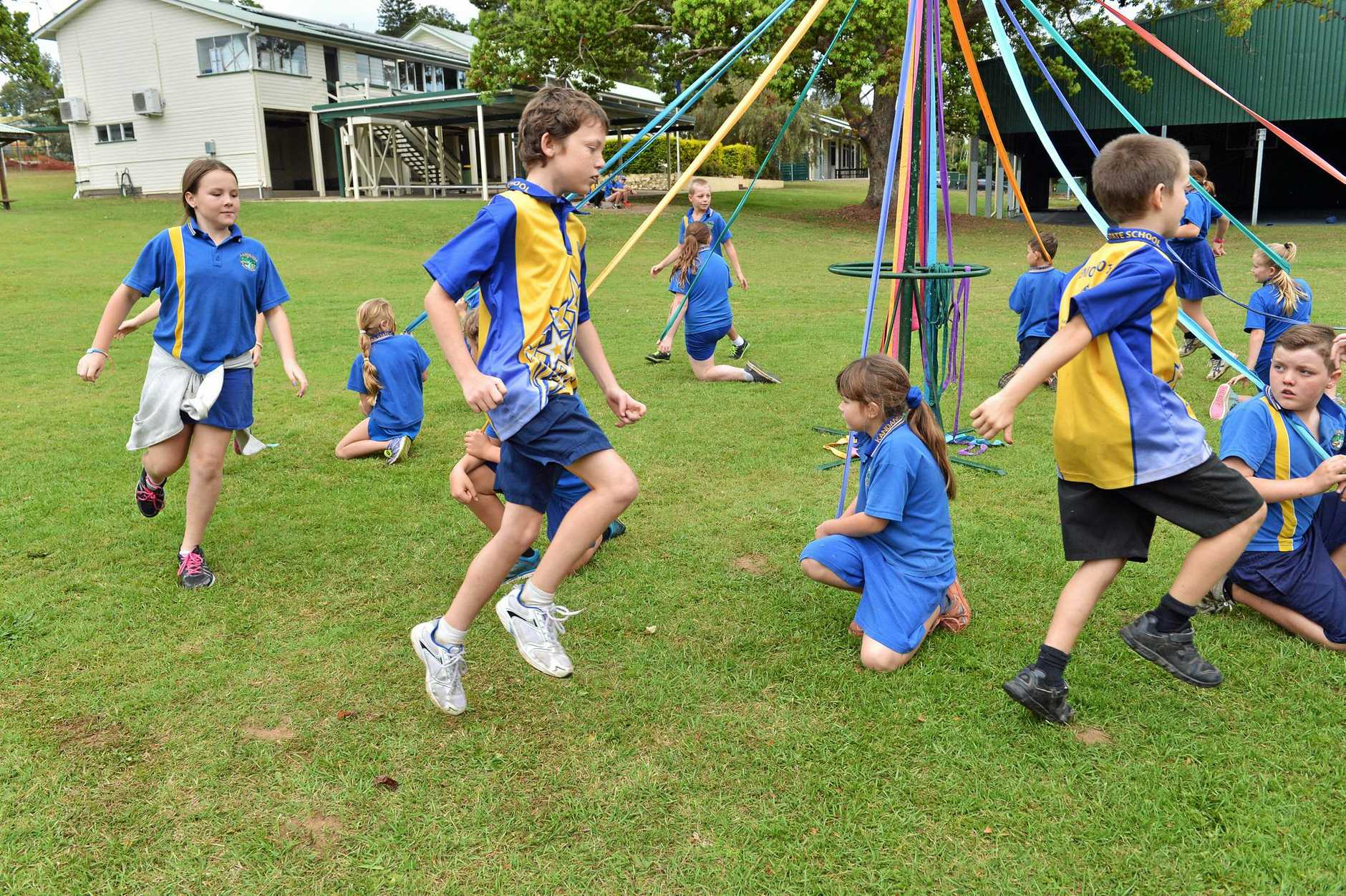 Students rehearsing their maypole dance for the centenary in 2015.