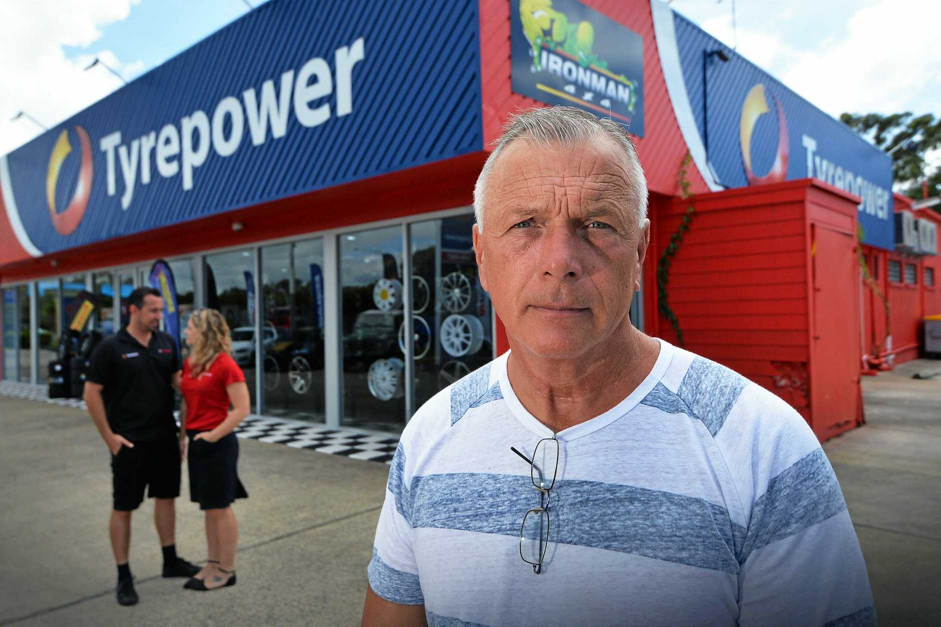 NOT HAPPY: Terry Marsay (front) copped a huge water bill from Unitywater after a leak at his commercial building in Caloundra where his son Ryan (rear) and partner Rebecca Blade, operate Tyrepower.