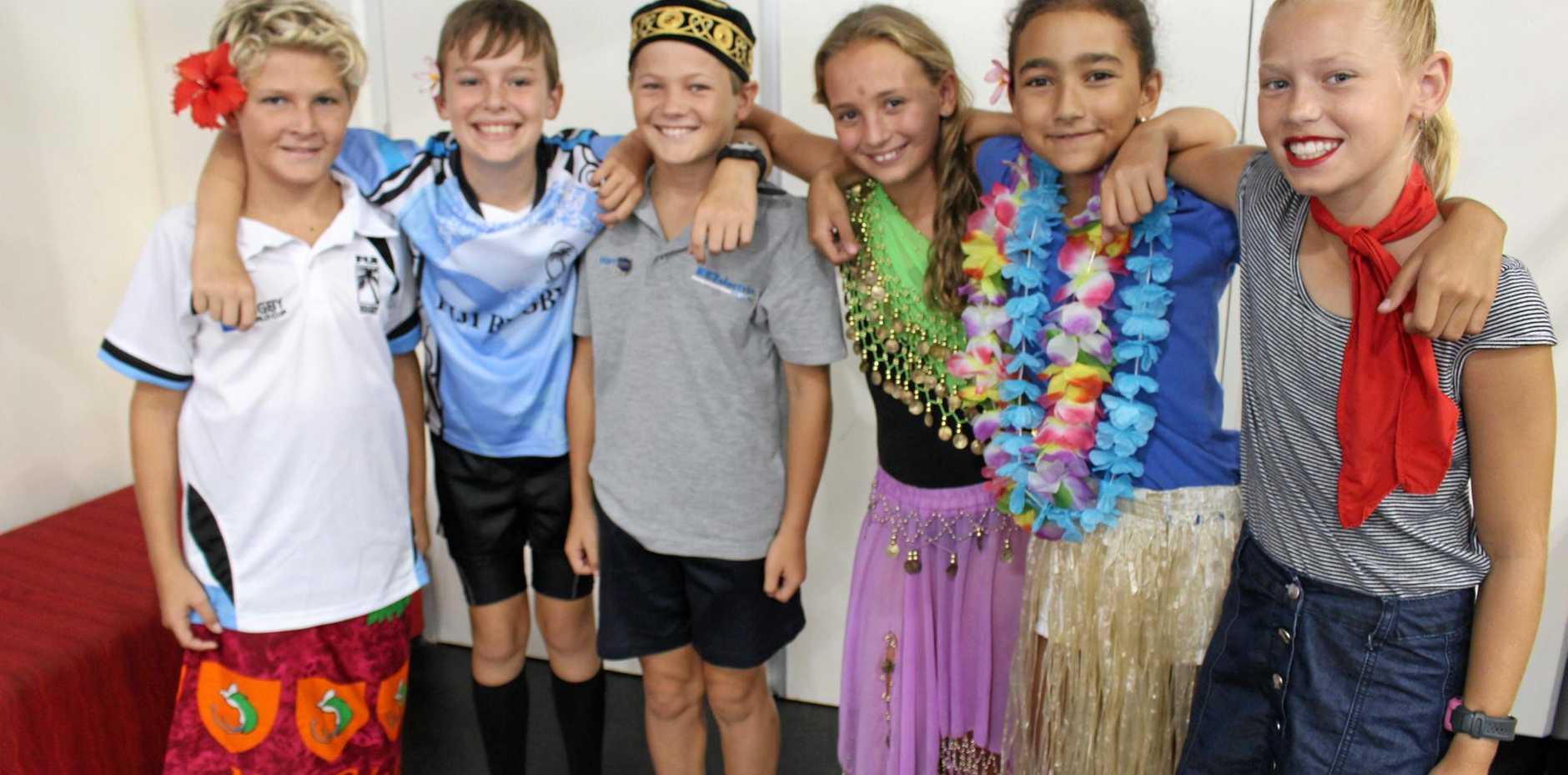 ONE BIG, HAPPY SCHOOL: Tom Sturgeon, Jake Veldman, Harry Rezek, Lucy Wolfenden, Tara Sokovagone and Ash Tanner enjoy Harmony Day at Kawana Waters State College this month.