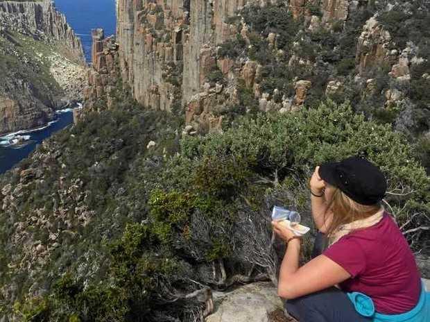 Fiona Morrison takes a break near Cape Pillar on Tasmania's Three Capes Track.