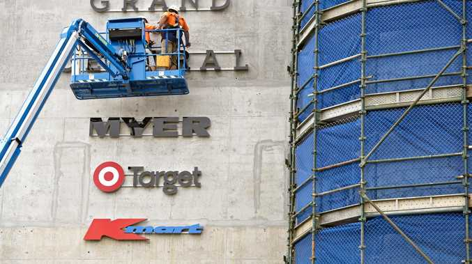 STAGE TWO: Signs for Kmart, BigW, Target and Myer are installed on the wall of the car park at Grand Central.