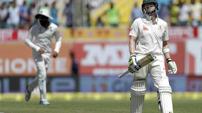 Australia's captain Steven Smith leaves the ground after being dismissed by India's Bhuvneshwar Kumar.