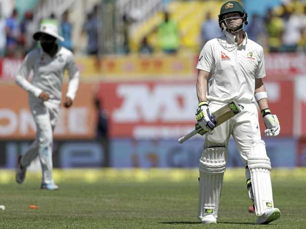 Australia's captain Steven Smith leaves the ground after being dismissed by India's Bhuvneshwar Kumar.