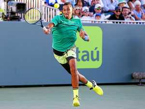Kyrgios hangs on for gritty win over Karlovic