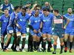 Western Force players celebrate after scoring a try against the Queensland Reds in round two of the 2017 Super Rugby season.