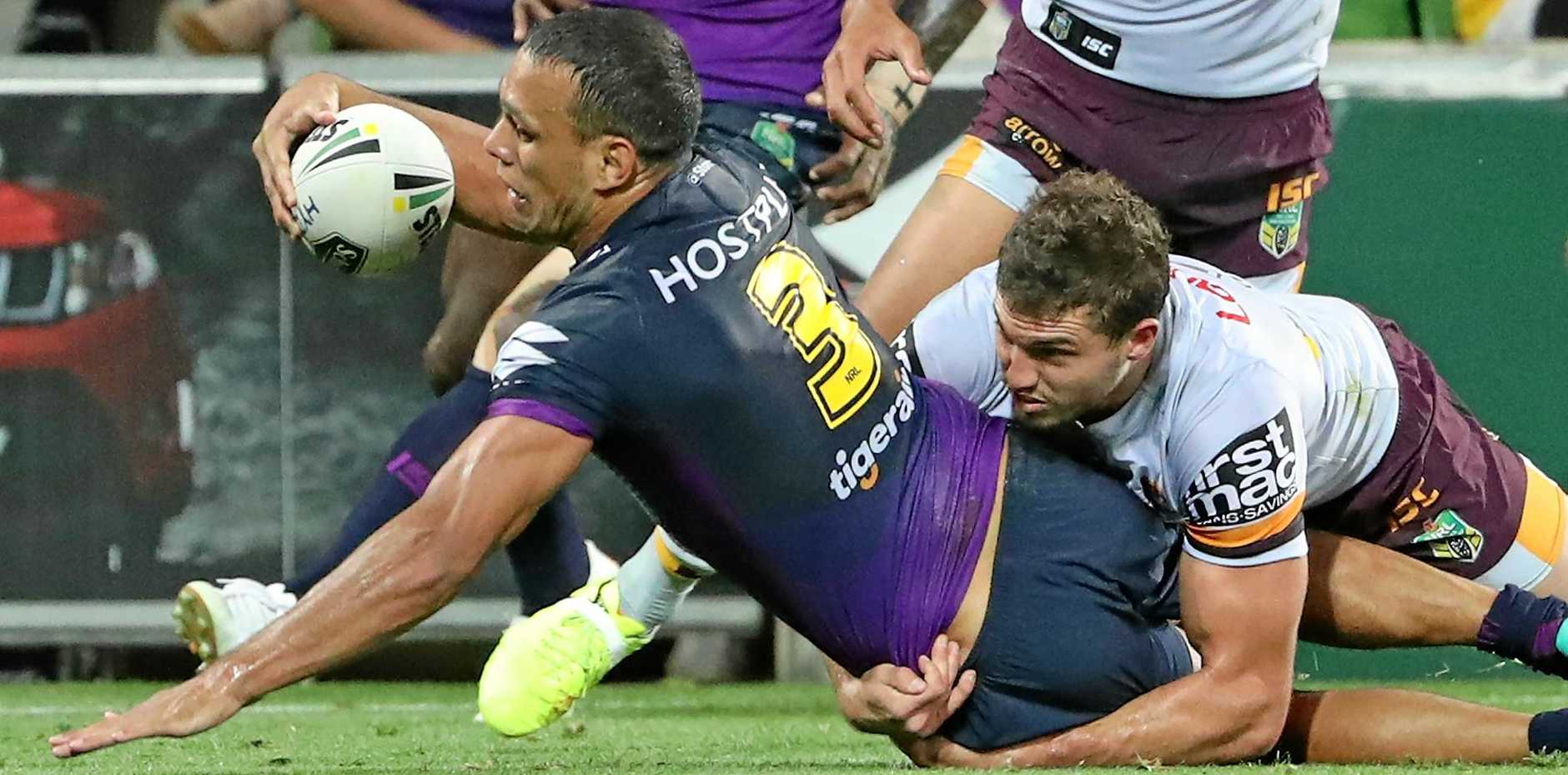 Will Chambers of the Melbourne Storm puts the ball over the line, only for the try to be disallowed, during the round-three NRL match against the Brisbane Broncos at AAMI Park.