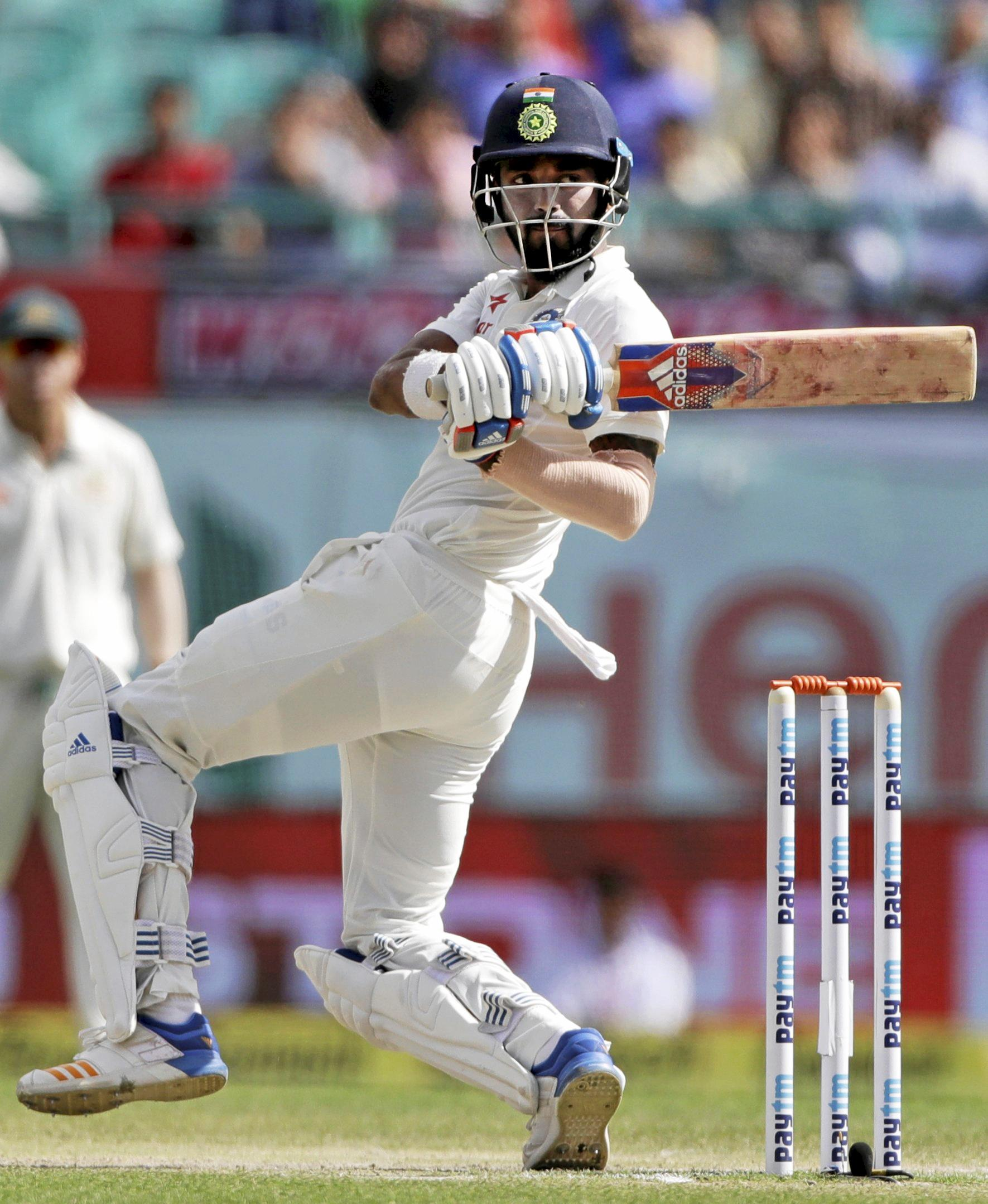 India's KL Rahul plays a shot during the fourth day of the fourth Test cricket against Australia in Dharmsala.