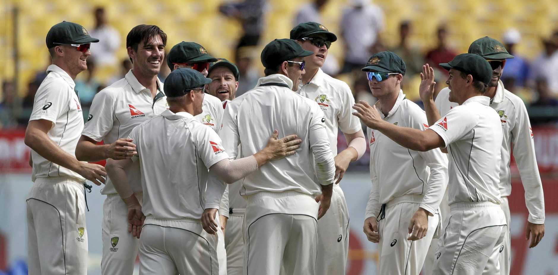 Australia celebrates the dismissal of India's Cheteshwar Pujara during the fourth day of the fourth Test.
