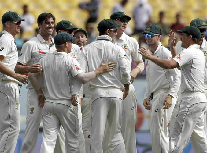 Australia celebrates the dismissal of India's Cheteshwar Pujara during the fourth day of the fourth Test.