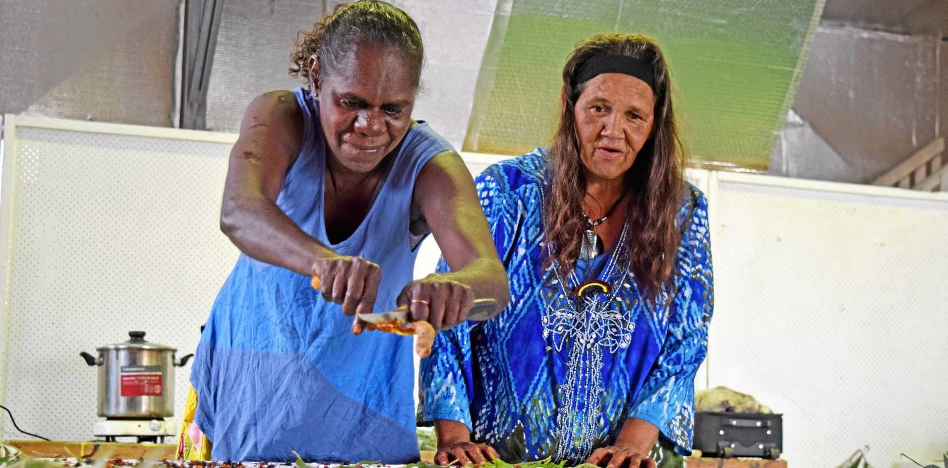 COLLABORATION: Kunwinjku and Bundjalung women work side by side using plants to dye silk at Jambama Arts Centre in Casino.