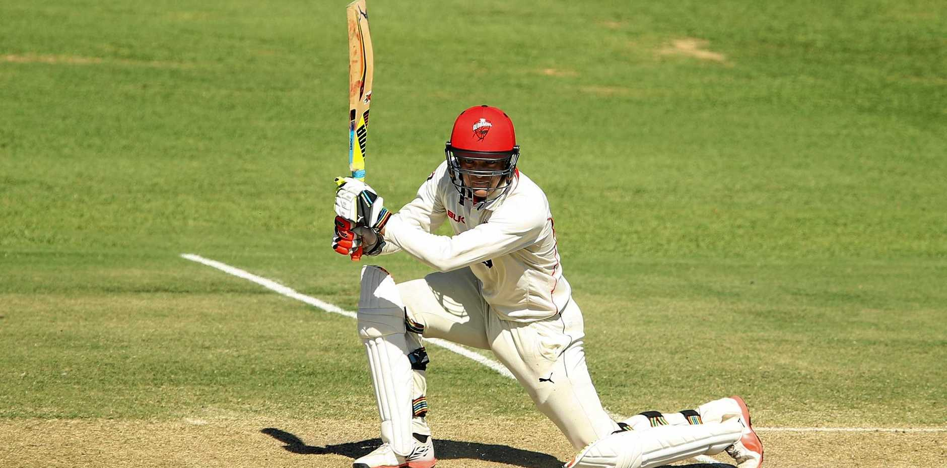 Alex Carey of the Redbacks plays a cover drive during the Sheffield Shield final between Victoria and South Australia in Alice Springs.