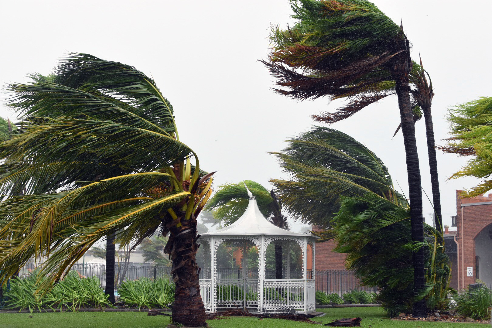 Strong winds lash Bowen, Tuesday, March 28, 2017. Cyclone Debbie's destructive core is battering the exposed mainland town of Airlie Beach where it has damaged homes and snapped trees after blasting Whitsunday Islands with wind gusts above 260km/h. Photo: AAP, Sarah Motherwell