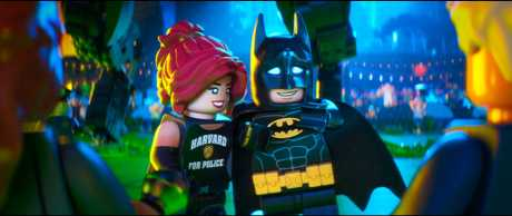 The characters Barbara Gordon and Batman in a scene from The LEGO Batman Movie.