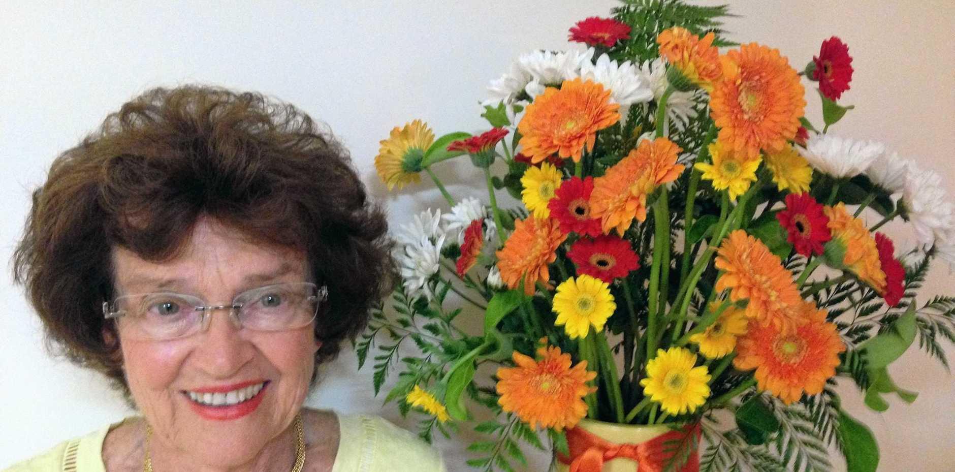 NEW HOBBY: Floral artist Desley Clarke with her award-winning floral art.