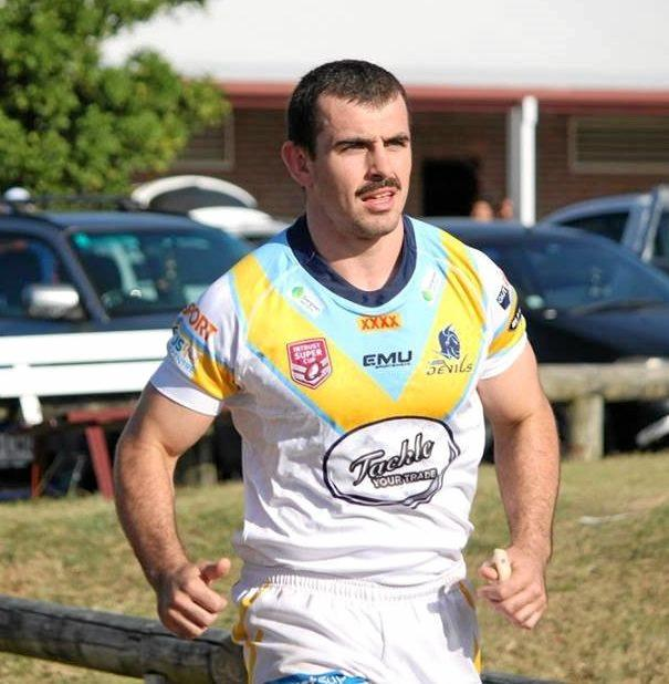 Rockhampton Brothers junior Stephen Coombe warming up for the Norths Devils.