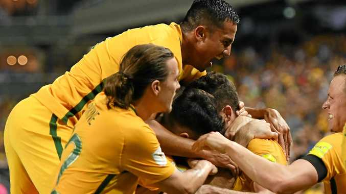 Australia's Tim Cahill celebrates with teammates after Mathew Leckie's goal at the Sydney Football Stadium.