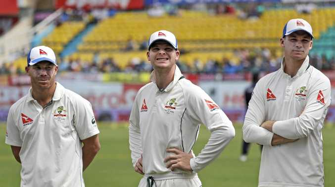 Australia's captain Steven Smith (centre), with David Warner (left) and Peter Handscomb (right)